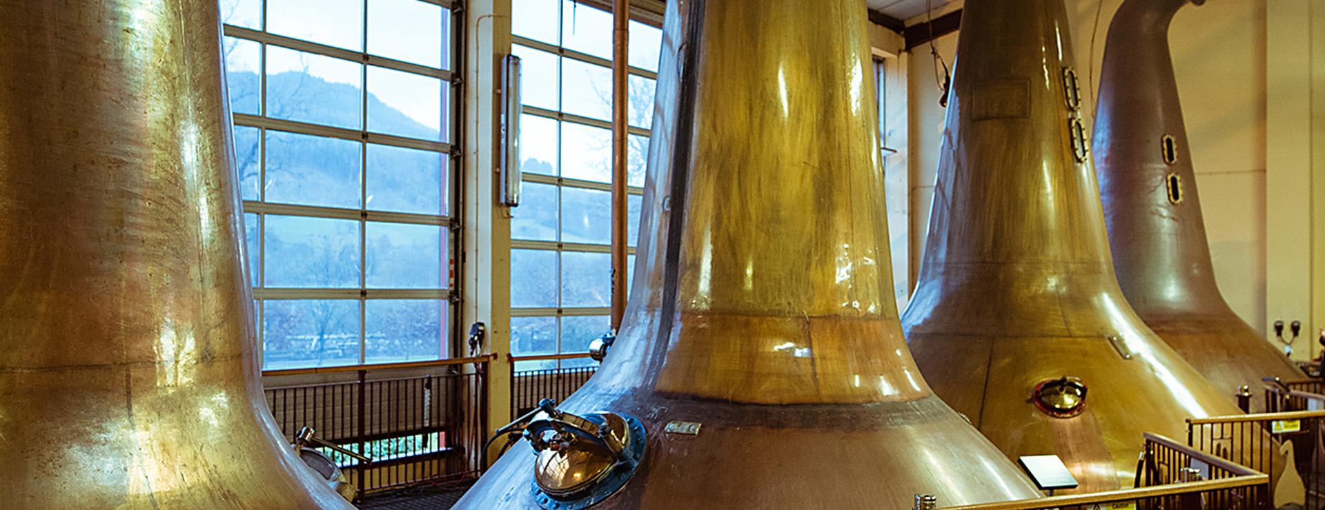 Copper pot stills on the distillery tour at Dewar's Aberfeldy Distillery